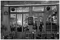 Popular cafe restaurant by night. Paris, France ( black and white)