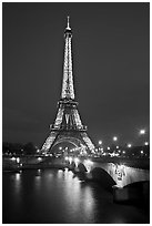 Seine River, Iena Bridge, and illuminated Eiffel Tower. Paris, France ( black and white)