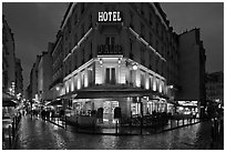 Hotel and pedestrian streets at night. Quartier Latin, Paris, France (black and white)
