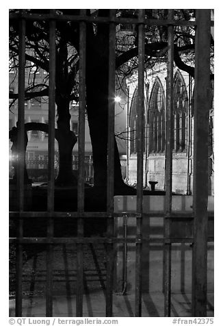 Cluny thermes behind iron grids by night. Quartier Latin, Paris, France (black and white)