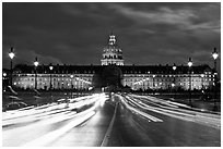 Les Invalides hospital and chapel dome with light trails from traffic. Paris, France (black and white)