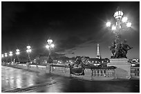 Lamps on Pont Alexandre III by night. Paris, France ( black and white)