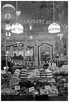 Pastries in bakery storefront. Paris, France (black and white)