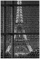 Illuminated Eiffel Tower seen through peace memorial. Paris, France ( black and white)