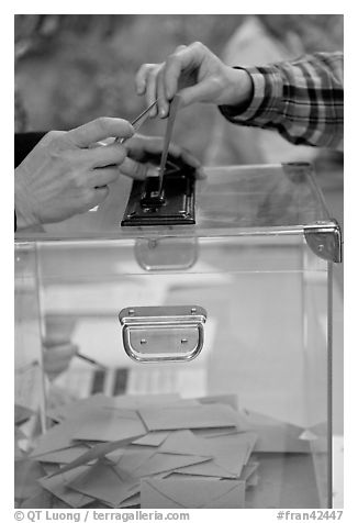 Ballot box with hands. Paris, France (black and white)