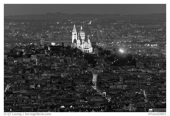Montmartre Hill and Sacre-Coeur basilica at night. Paris, France (black and white)