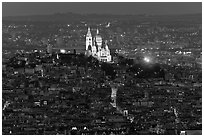 Montmartre Hill and Sacre-Coeur basilica at night. Paris, France ( black and white)