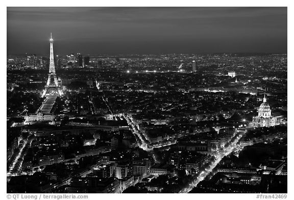 Aerial view at night with Eiffel Tower, Invalides, and Arc de Triomphe. Paris, France (black and white)