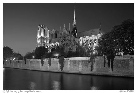 Side view of Notre Dame across Seine River at dusk. Paris, France (black and white)