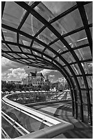 Curvy glass and metal structure framing historic Saint-Eustache church. Paris, France (black and white)