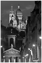 Church of Notre-Dame-de-Lorette with the Basilica of the Sacre Coeur behind at night. Paris, France (black and white)