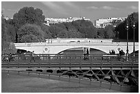 Steel and stone bridges over the Seine River. Paris, France ( black and white)