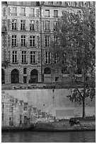 Quay and riverfront buildings on banks of the Seine. Paris, France (black and white)