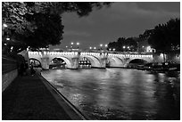 Quay, Seine River, and Pont-Neuf at night. Paris, France ( black and white)