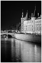 Conciergerie reflected in Seine river at night. Paris, France (black and white)