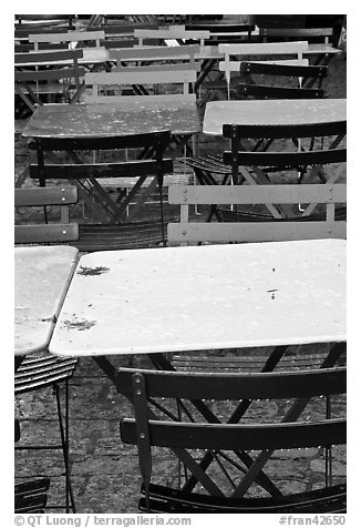 Wet tables and chairs, Montmartre. Paris, France (black and white)