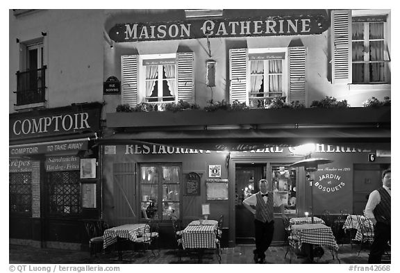 Restaurant and waiter at night, Montmartre. Paris, France (black and white)