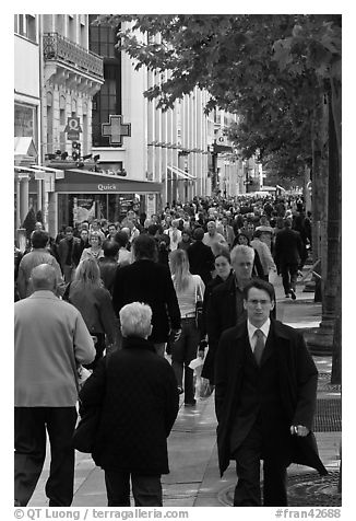 Dense pedestrian traffic on Champs-Elysees. Paris, France (black and white)