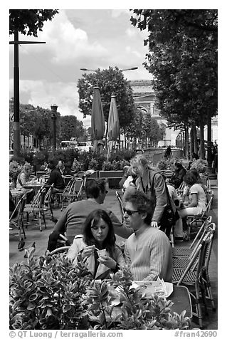 Couple at outdoor cafe on the Champs-Elysees. Paris, France (black and white)
