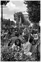 Couple at outdoor cafe on the Champs-Elysees. Paris, France ( black and white)