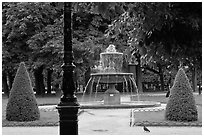 Cortot Fountain in park, place des Vosges. Paris, France (black and white)