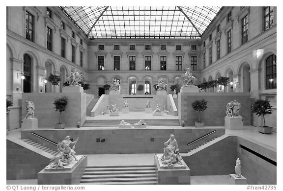 Louvre Museum room with sculptures and skylight. Paris, France (black and white)