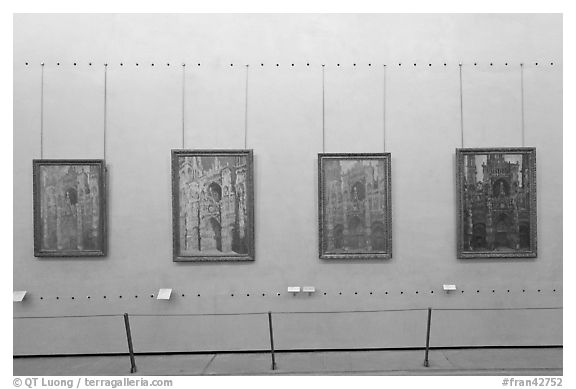 Monet's impressionist paintings of the Rouen Cathedral, Musee d'Orsay. Paris, France (black and white)