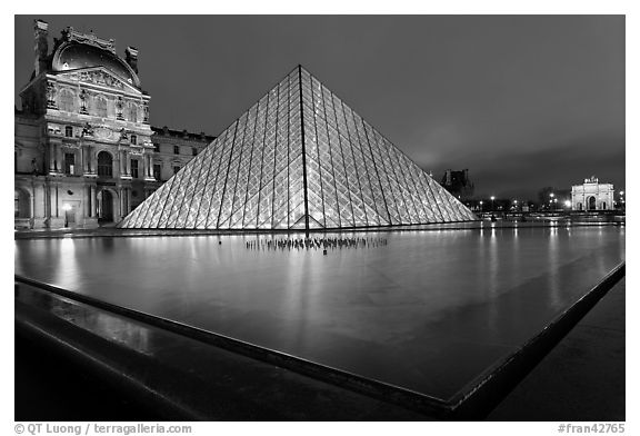IM Pei Pyramid and reflection ponds at night, The Louvre. Paris, France (black and white)