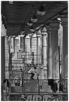 Youngsters skateboarding below metro bridge. Paris, France (black and white)