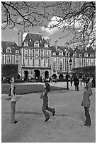 Girls playing with rope, Place des Vosges. Paris, France ( black and white)