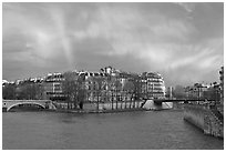 Clearing storm with rainbow above Saint Louis Island. Paris, France (black and white)