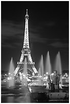 Tour Eiffel (Eiffel Tower) and Fountains on the Palais de Chaillot by night. Paris, France (black and white)