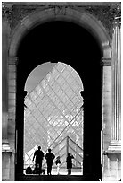 Pyramid seen through one of the Louvre's Gates. Paris, France (black and white)