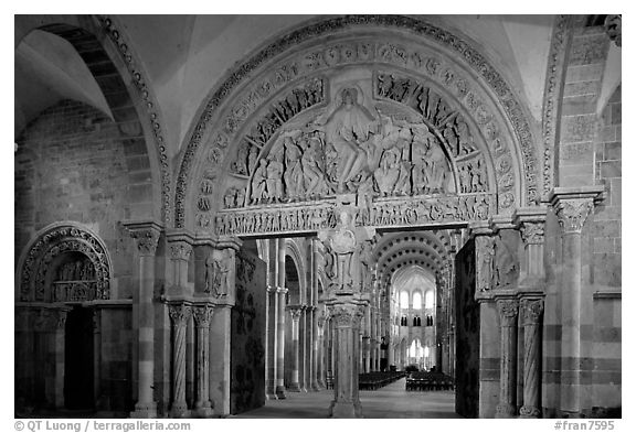 Sculpted doors and typhanum inside the Romanesque church of Vezelay. Burgundy, France (black and white)