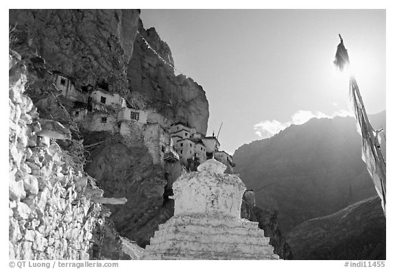 Chorten, prayer flag, and Phuktal Gompa, Zanskar, Jammu and Kashmir. India (black and white)