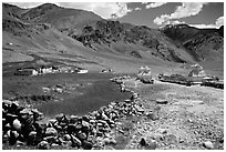 Stone fence, chortens, cultivations, and village, Zanskar, Jammu and Kashmir. India (black and white)