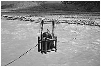 Trekker crossing a river by cable, Zanskar, Jammu and Kashmir. India ( black and white)