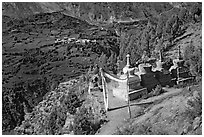 Prayer flag, chortens, and verdant valley below, Himachal Pradesh. India (black and white)
