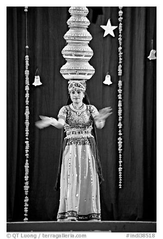 Rajasthani dancer with balanced jars. New Delhi, India (black and white)