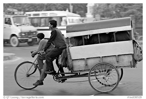 Cycle-rickshaw pulling a box for carrying schoolchildren. New Delhi, India (black and white)