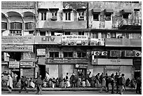 Street with many people waiting in front of closed stores, Old Delhi. New Delhi, India (black and white)