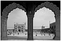 Courtyard of mosque seen through arches of prayer hall, Jama Masjid. New Delhi, India ( black and white)