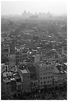 View of Old Delhi from above with high rise skyline in back. New Delhi, India ( black and white)