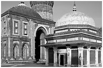 Tomb of Imam Zamin, Alai Darweza gate, and base of  Qutb Minar. New Delhi, India (black and white)