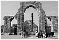 Iron pillar, and ruined mosque arch, Qutb complex. New Delhi, India (black and white)