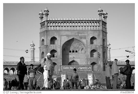 Early morning activity under Jama Masjid East Gate. New Delhi, India (black and white)