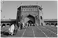 Muslim worshippers climbing  Jama Masjid South Gate. New Delhi, India (black and white)