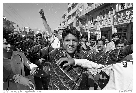 Young men celebrating during wedding procession. Jodhpur, Rajasthan, India (black and white)