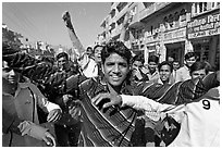 Young men celebrating during wedding procession. Jodhpur, Rajasthan, India ( black and white)