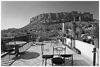 Rooftop restaurant with view on Mehrangarh Fort. Jodhpur, Rajasthan, India (black and white)